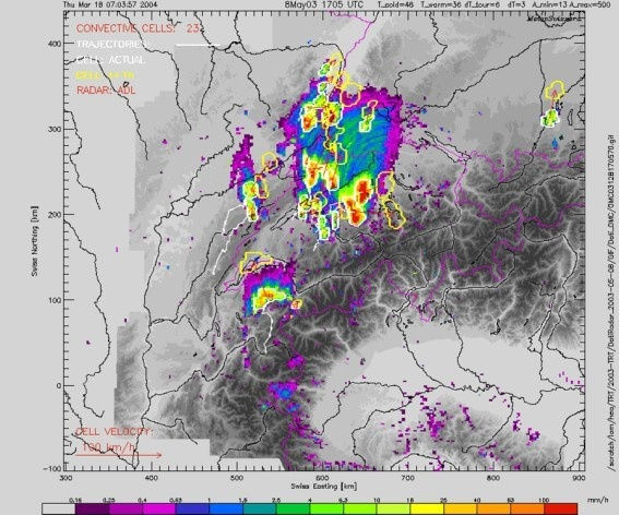 Vergrösserte Ansicht: TRT thunderstorms cells (white contours), trajectories (white lines) and extrapolated cells (+1h, yellow contours), superimposed on the precipitation radar image.